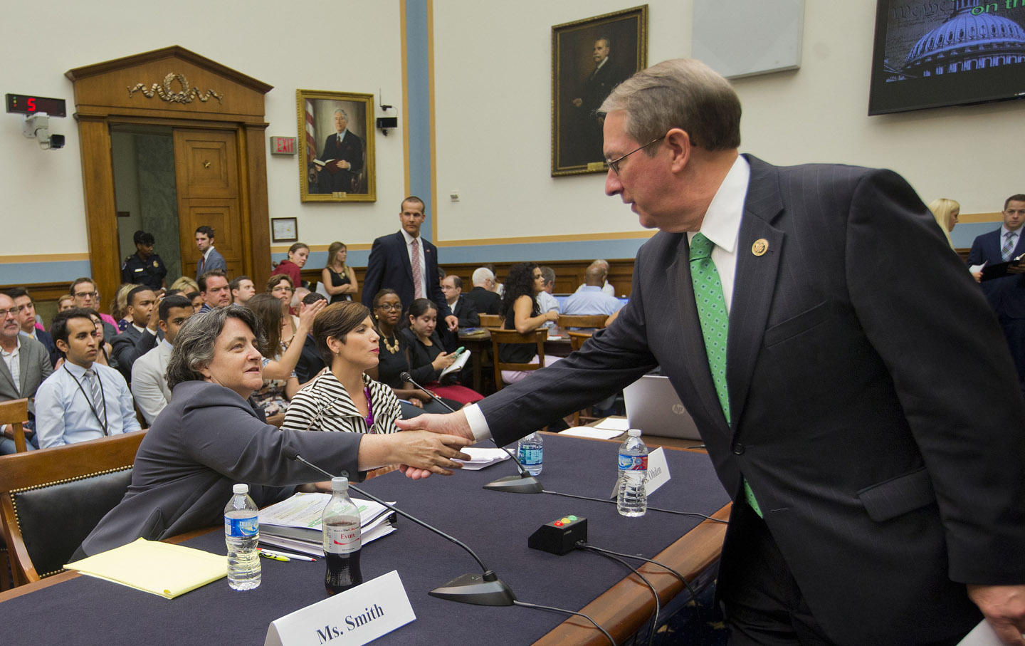 Representative Goodlatte greeting witnesses who appeared at the hearing