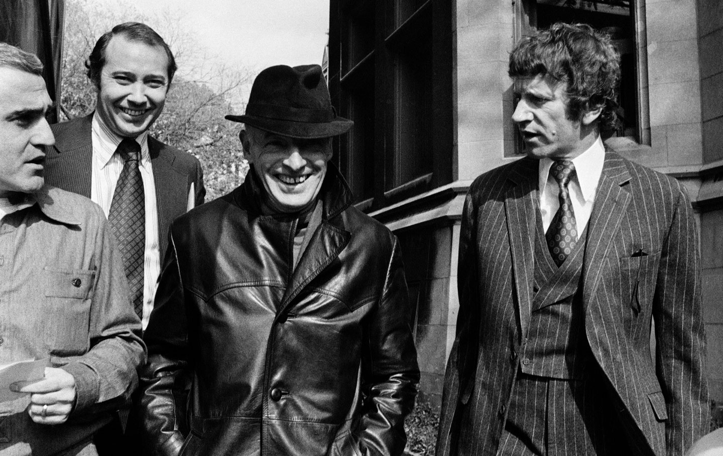 Saul Bellow (middle) after acknowledging his receipt of the Nobel Prize in Literature, October 22, 1976. (Credit: Charles Knoblock / AP)