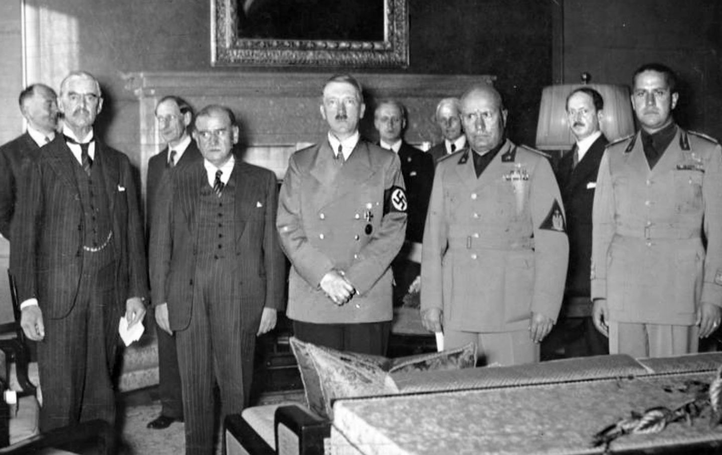 From left to right: Neville Chamberlain, Daladier, Adolf Hitler, Benito  Mussolini, and Galeazzo Ciano before signing the Munich Agreement.