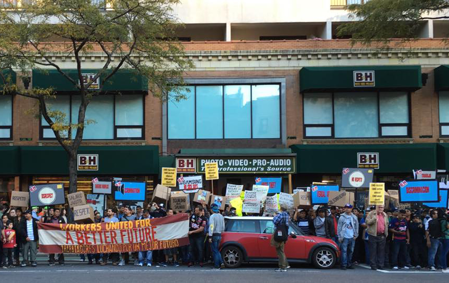 Workers protest outside a B&H store in New York.