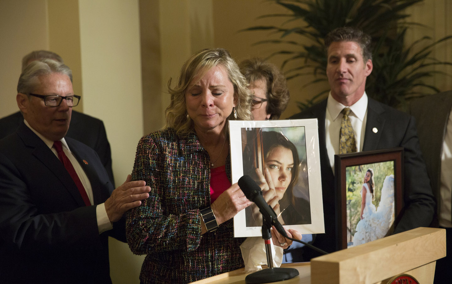 Debbie Ziegler holds a photograph of her daughter, Brittany Maynard, as she talks to the media in Sacramento, CA.