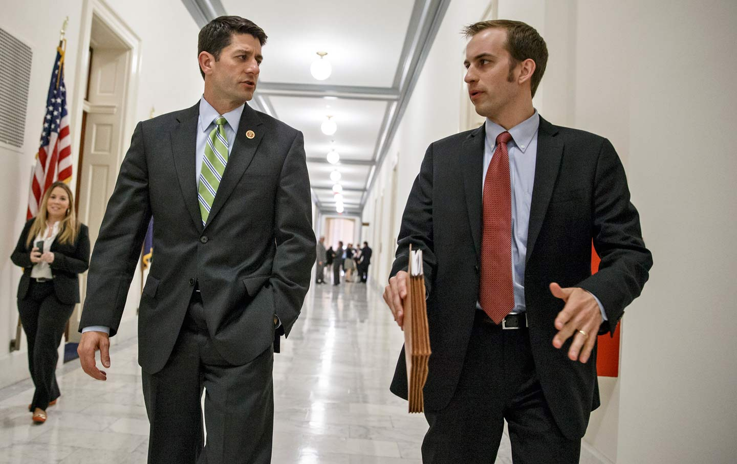 Paul Ryan confers with an aide.