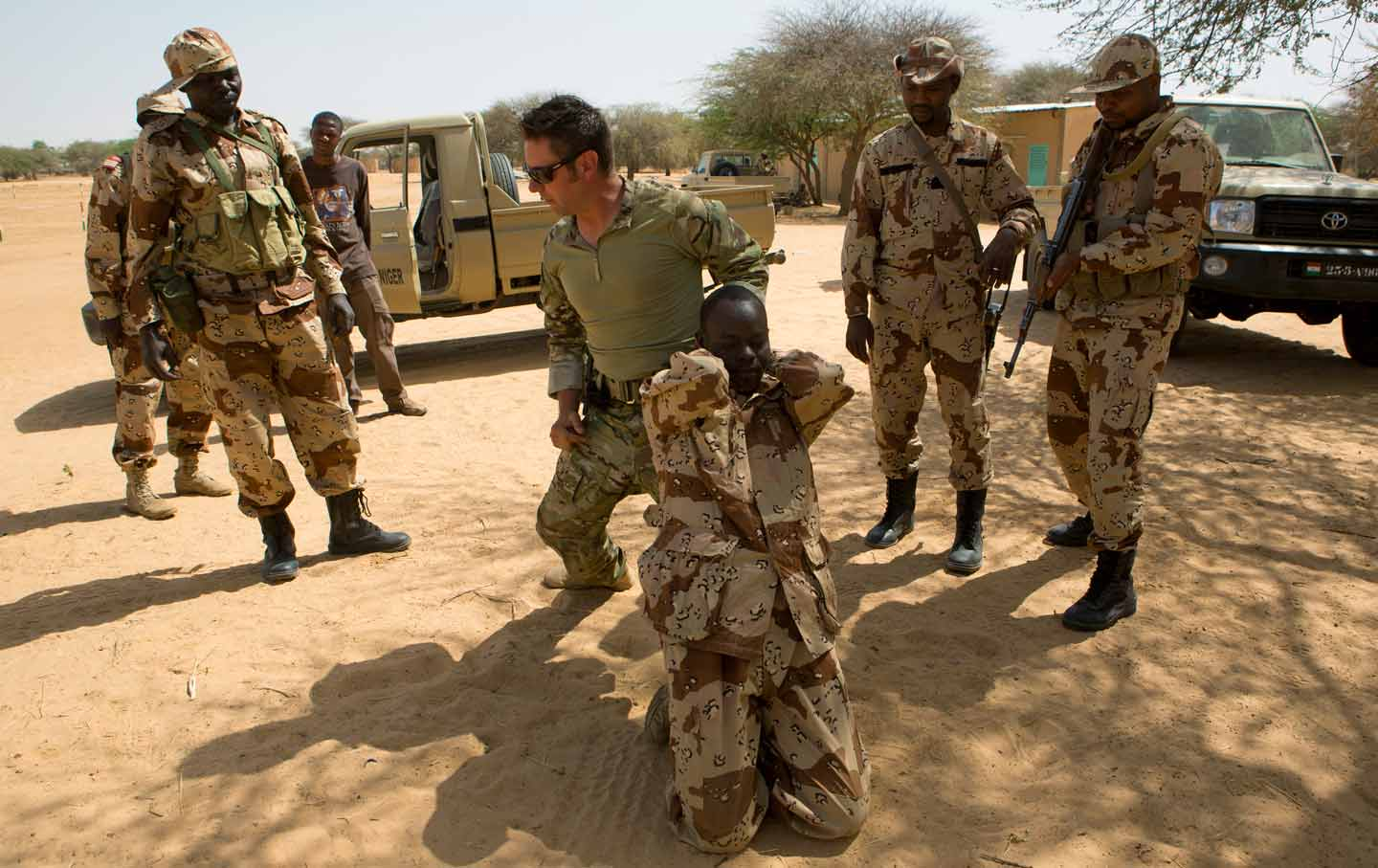 A US special forces soldier demonstrates how to detain a suspect during Flintlock, a US special forces training for African militaries, in Diffa, March 4, ...