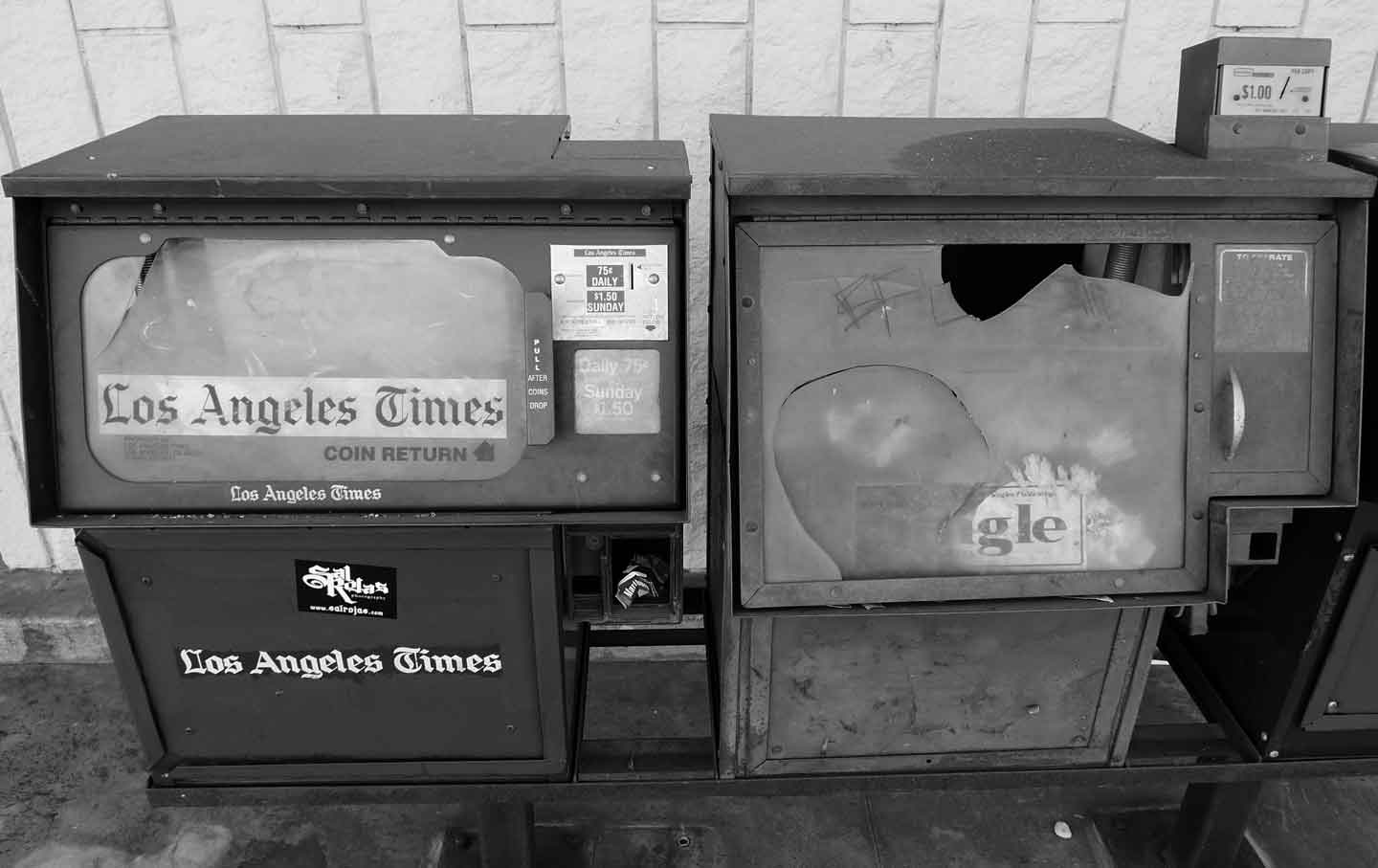Abandoned newspaper vending machines, Covina, California, 2011.