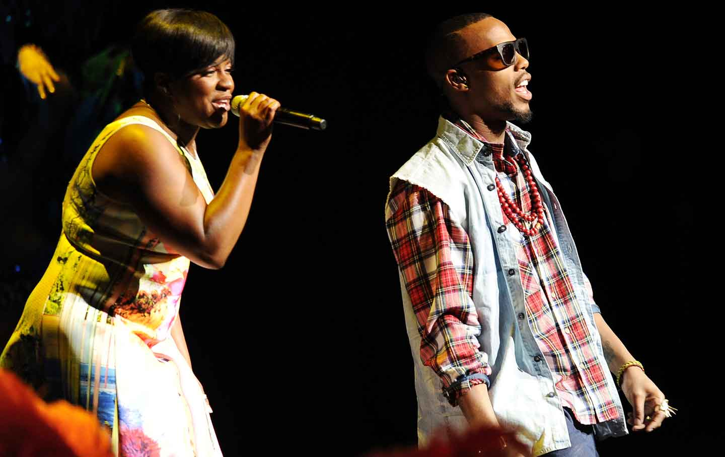 Ester Dean (left) and B.o.B. perform at CinemaCon, March 27, 2014.
