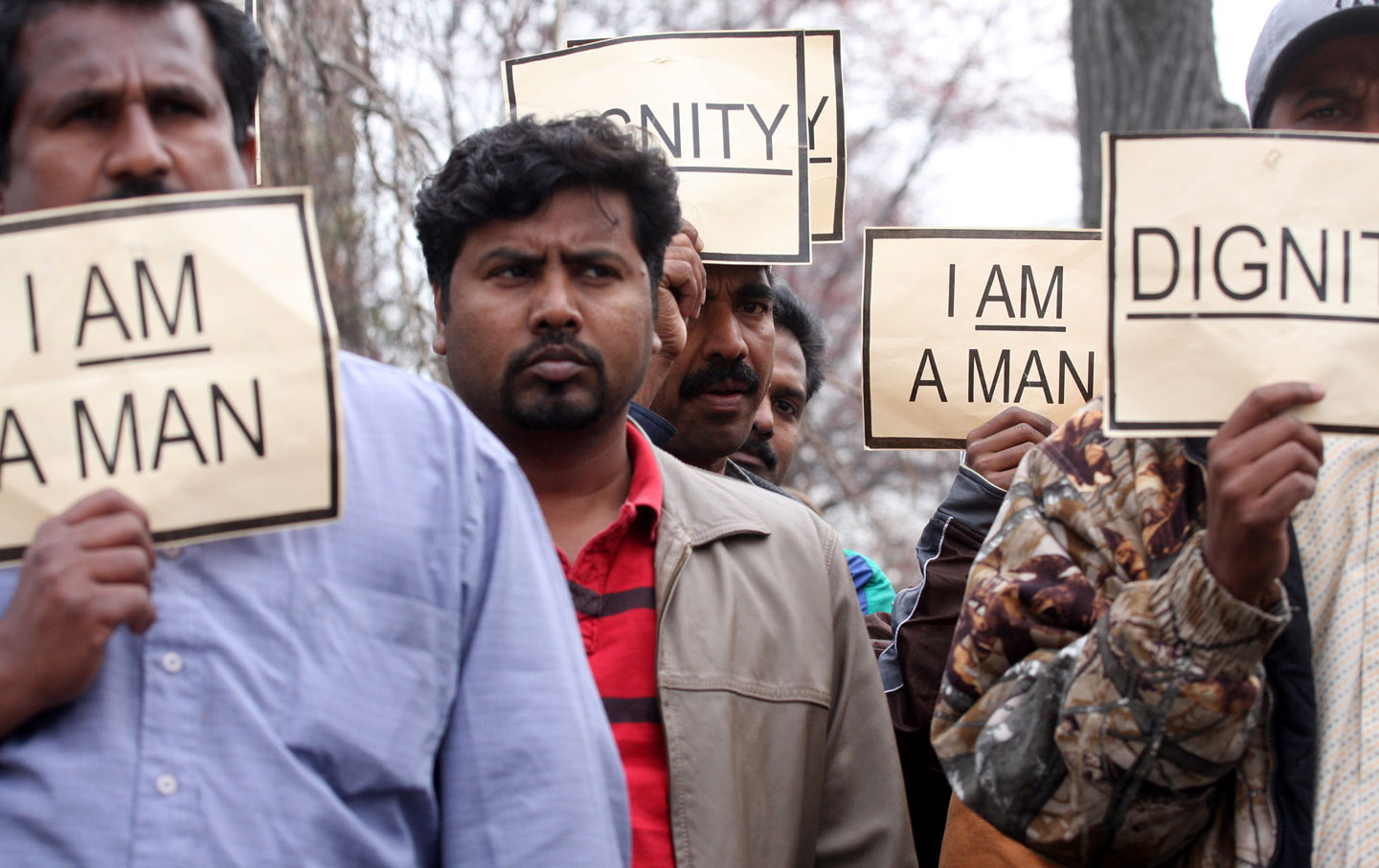 Indian workers take part in a protest outside the Indian Embassy in Washington, DC