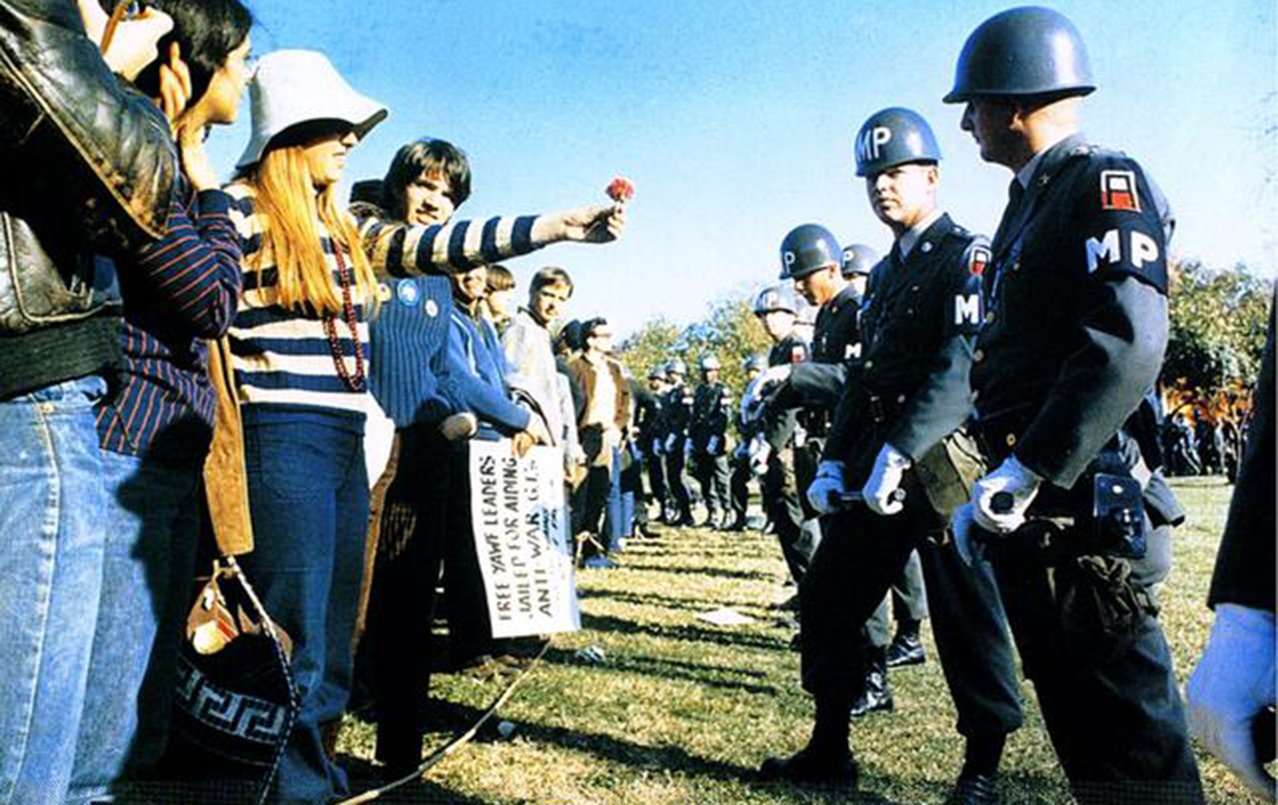 A demonstrator offers a flower to military police at a Vietnam War demonstration at the Pentagon in 1967.