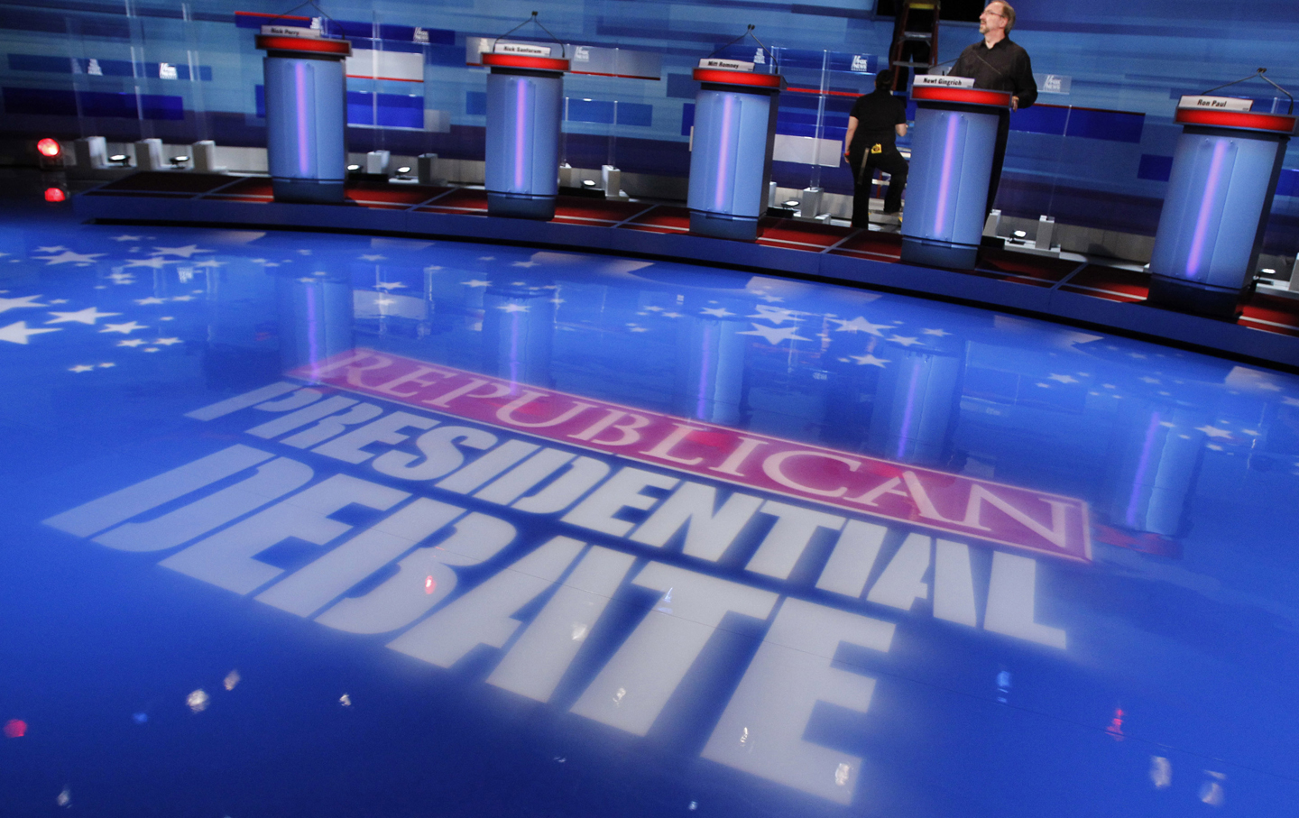Stage hands prepare for the South Carolina Republican presidential candidates debate in Myrtle Beach