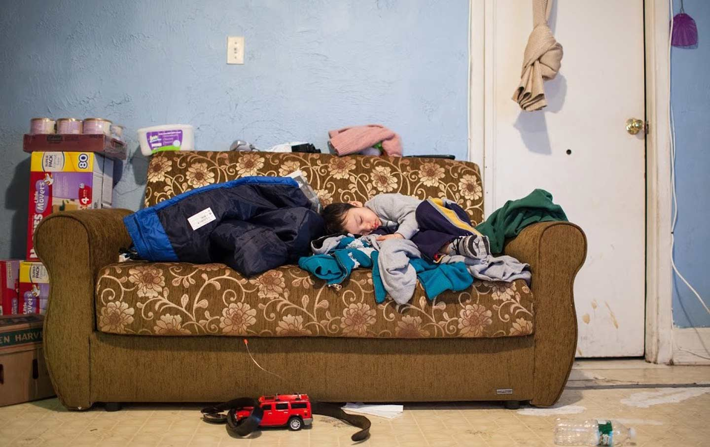 """A photograph from the """"Portraits of Hunger in NYC"""" exhibition features four-year-old Brandon, whose family makes a four-mile round trip to collect food at two Queens food pantries."""