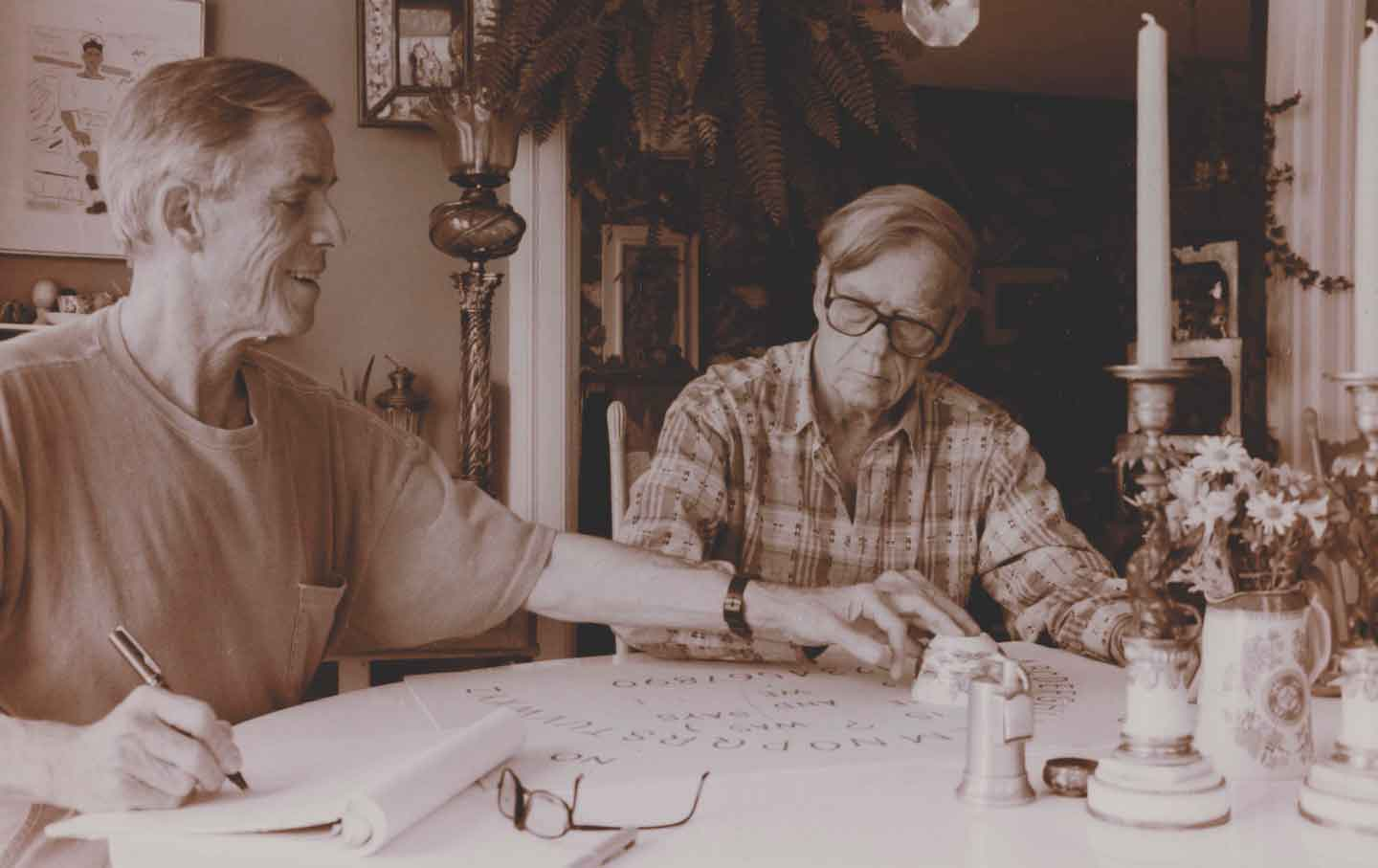 James Merrill (left) and David Jackson at the Ouija board in 1983.