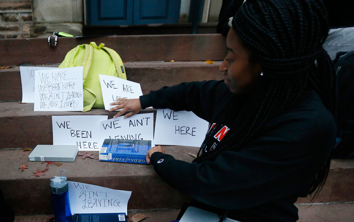 A student shows signs made for a sit-in to demand a range of changes to improve the social and academic experience of black students, at Princeton University, Wednesday, Nov. 18, 2015, in Princeton, N.J.