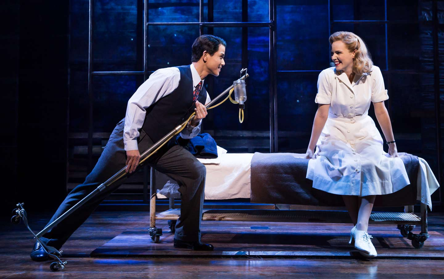 Interned Japanese American Sammy Kimura (Telly Leung) and camp nurse Hannah Campbell (Katie Rose Clarke) perform in Allegiance.