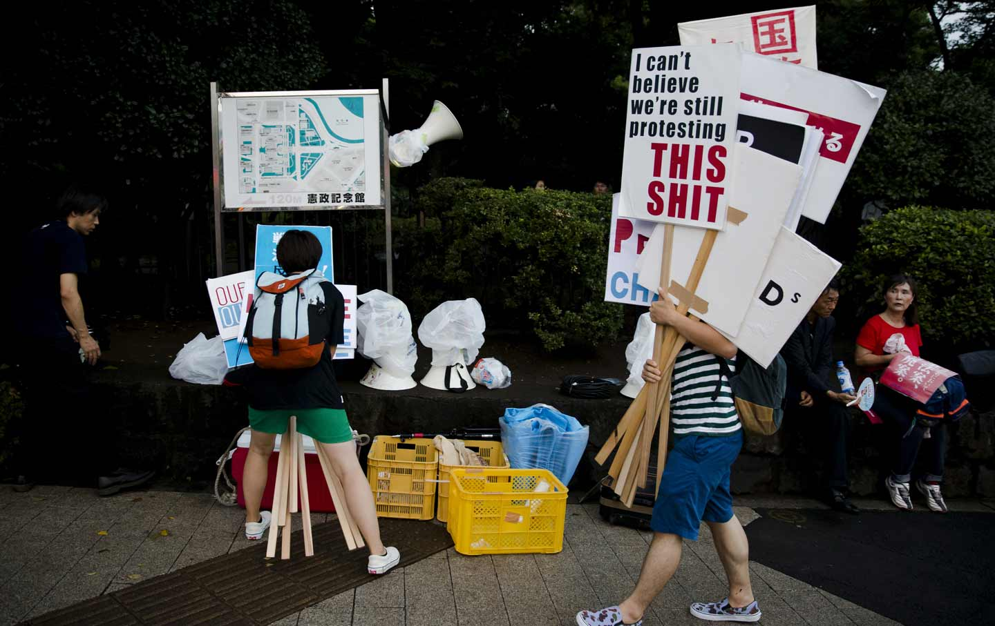 Members of the antiwar group SEALDs (Students Emergency Action for Liberal Democracy) rally outside Japan's parliament building, August 21, 2015.