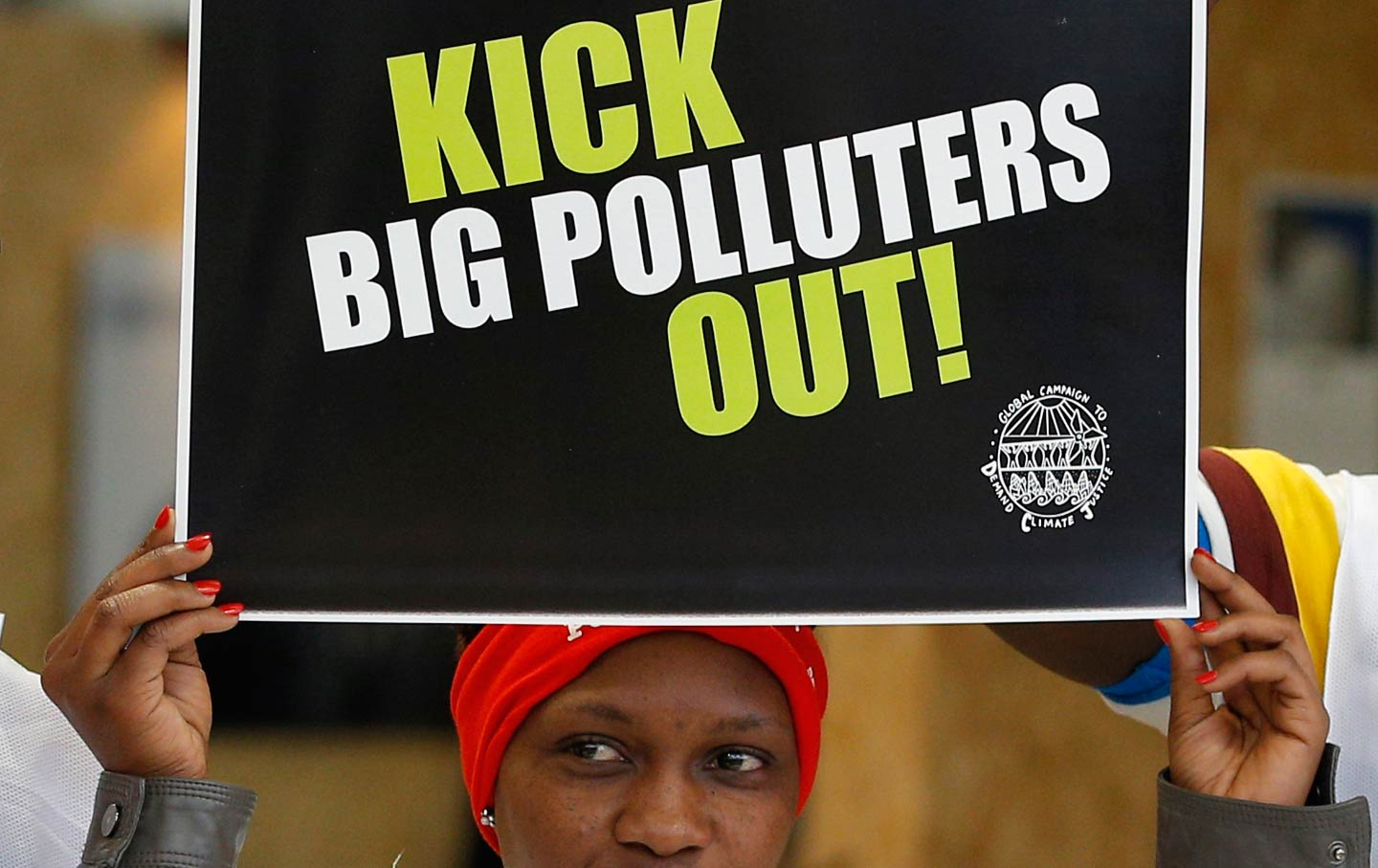An activist protesting polluters at the Climate Generations Areas at COP21, the United Nations Climate Change Conference, Wednesday, December 2, 2015.