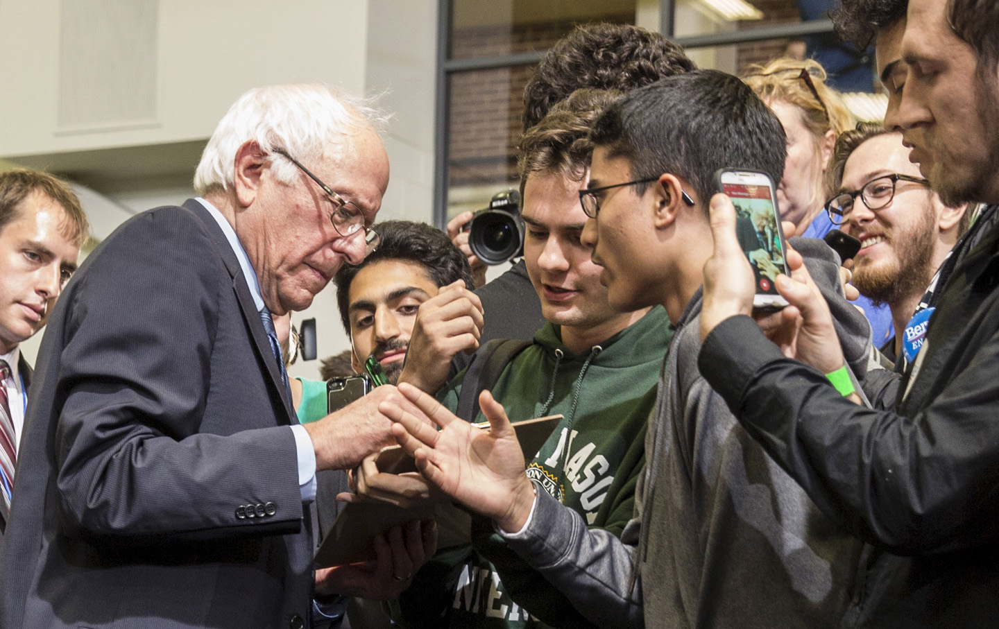 Democratic presidential candidate Sanders greets students after a town hall meeting with students at George Mason University in Fairfax
