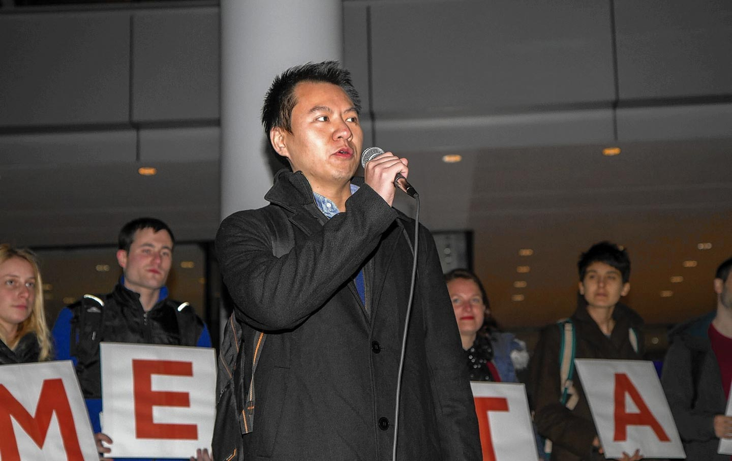 Graduate workers and supporters rally around Grant Mao at Yale University, December 8, 2015.