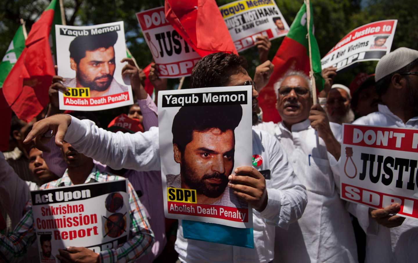 Social Democratic Party of India activists carrying placards with photographs of Yakub Memon, July 27, 2015.