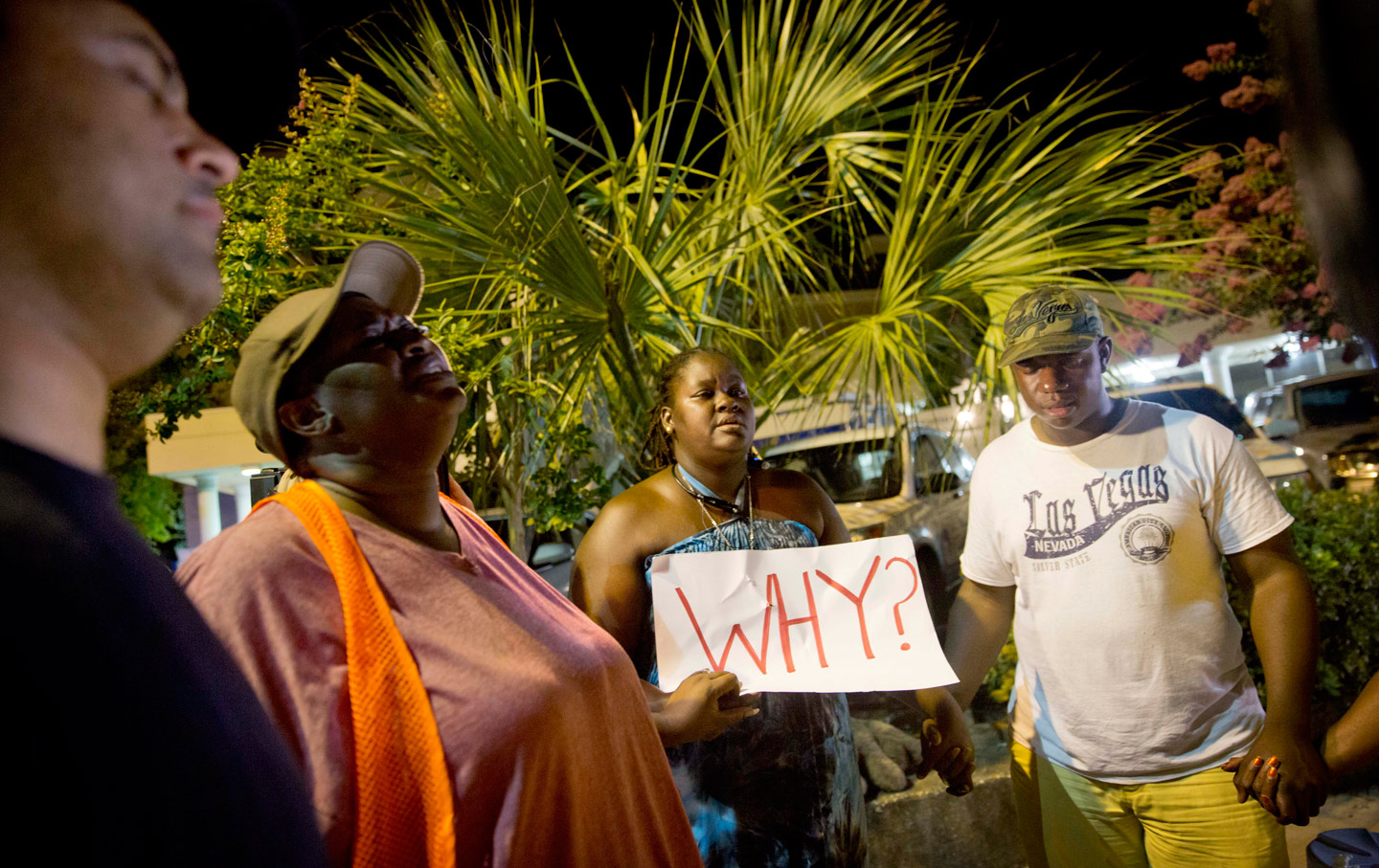 Surreace Cox, of North Charleston, South Carolina, holds a sign during a prayer vigil down the street from the Emanuel AME Church following the mass shooting there.