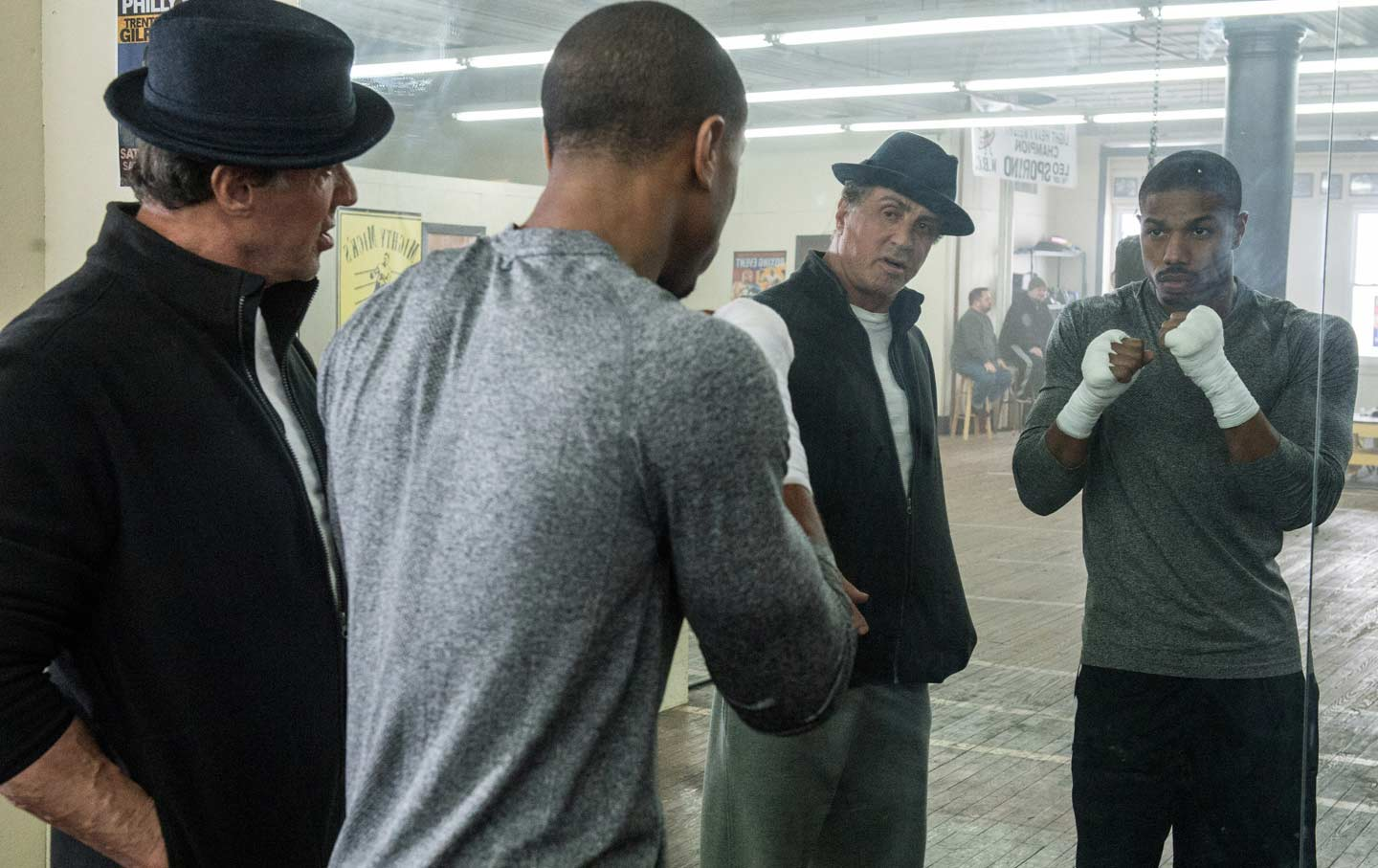 Sylvester Stallone (left) as Rocky Balboa and Michael B. Jordan as Adonis Johnson in Creed.