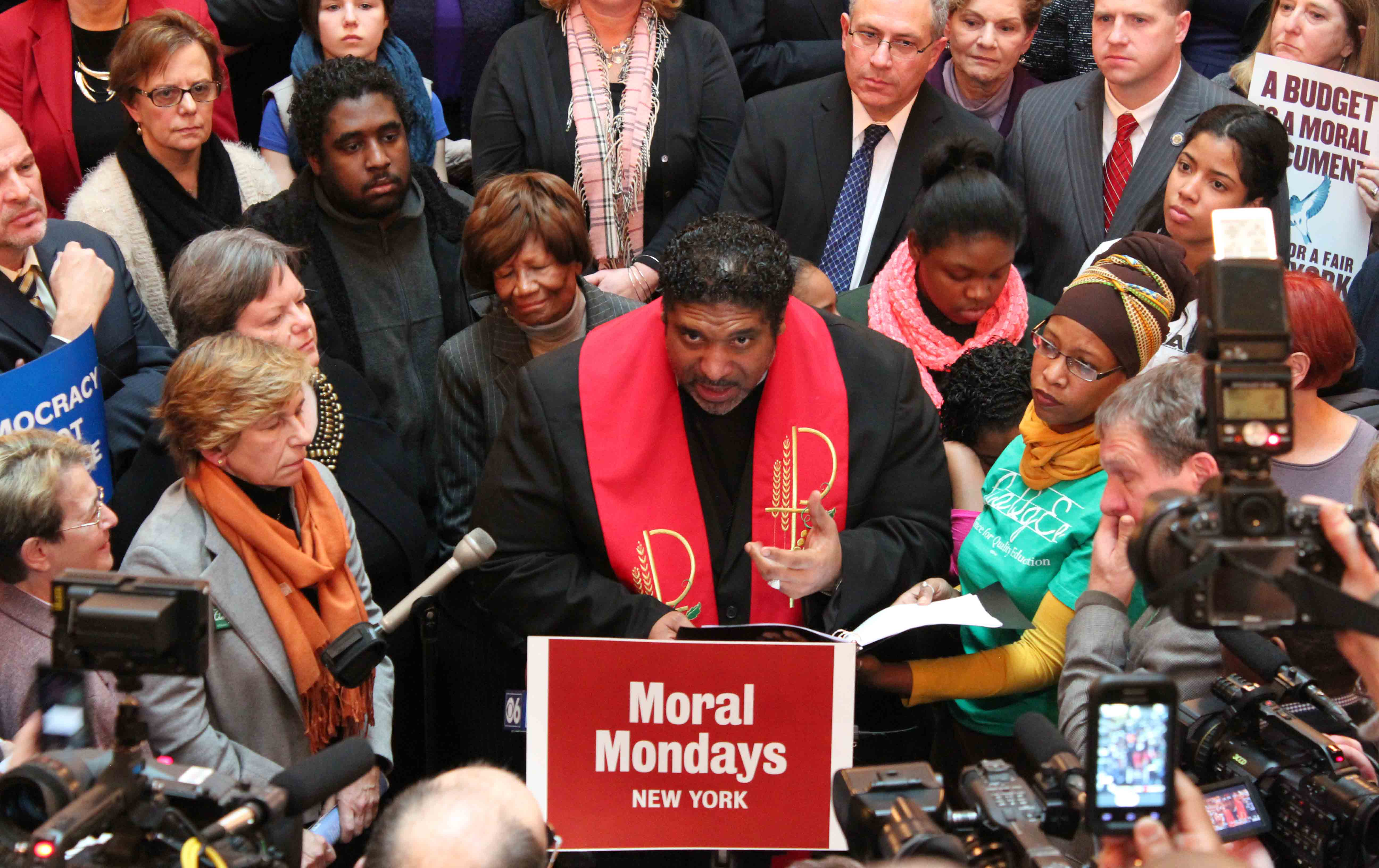 National movement: Rev. William Barber (center) speaks to media at a Moral Monday rally in Albany, New York, in 2014.