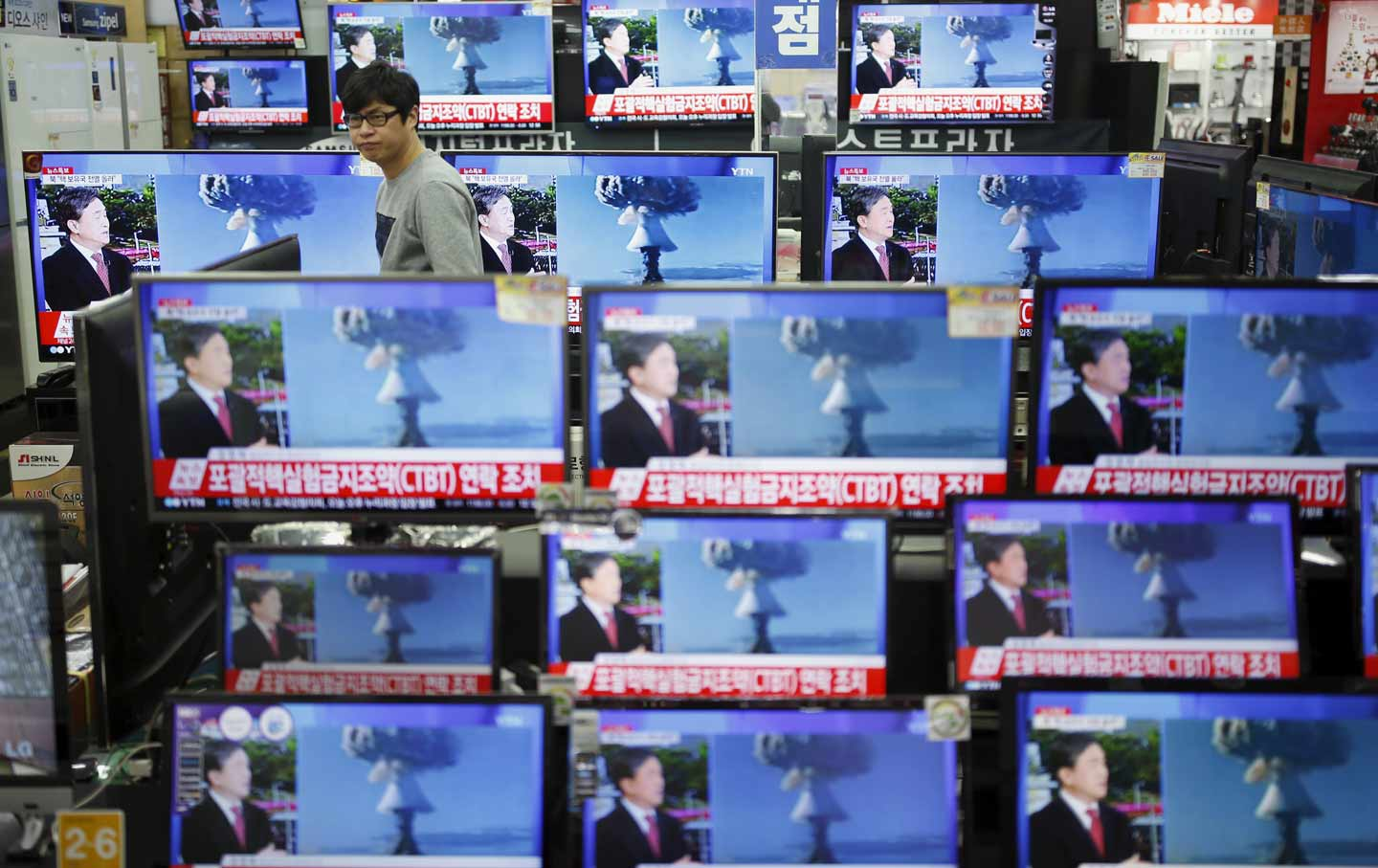 Televisions broadcast a report on North Korea's nuclear test.