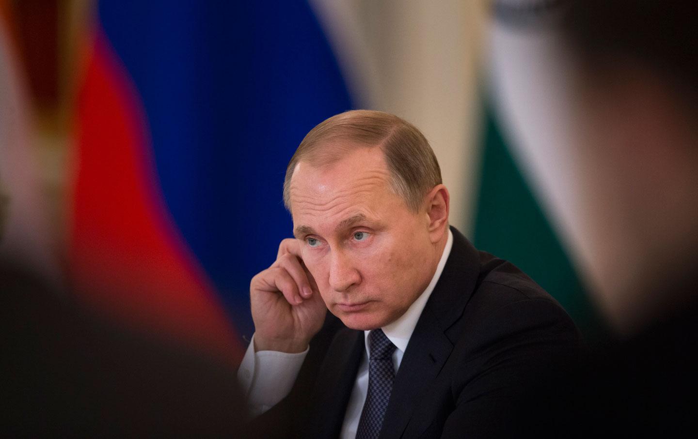 Russian President Vladimir Putin attends a meeting with Russian officials.