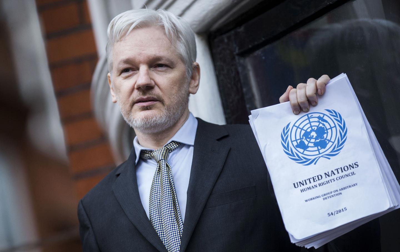 Julian Assange holds UN report