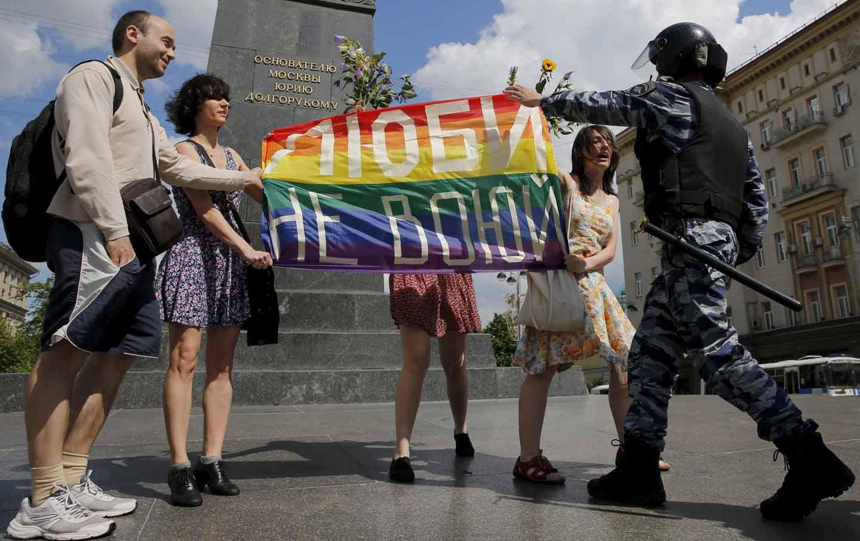 LGBT community rally participants encounter a policeman
