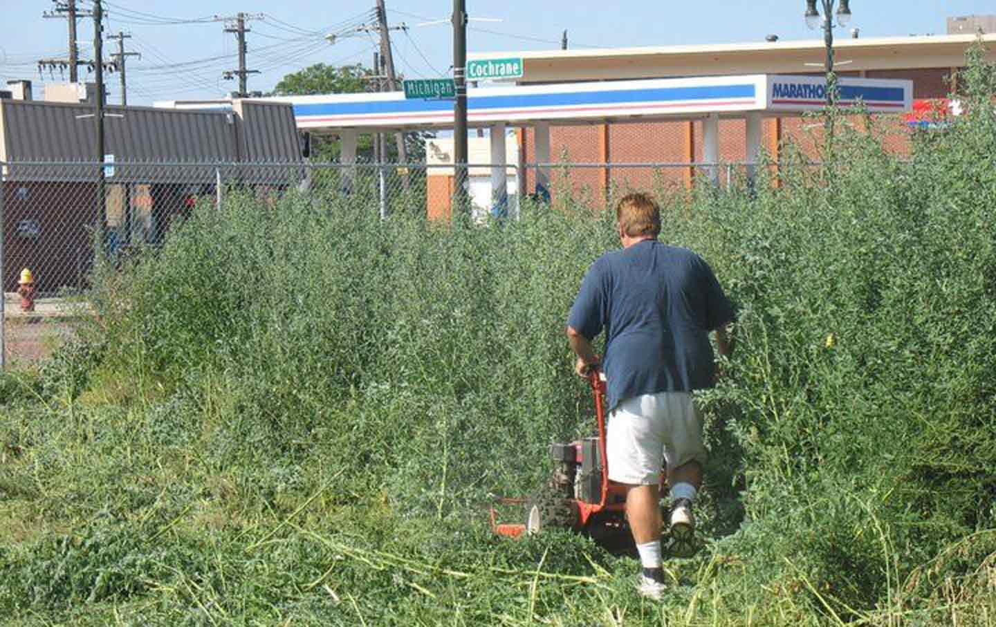 Tom Derry mows weeds on the site of the old Tiger Stadium, August 2010.