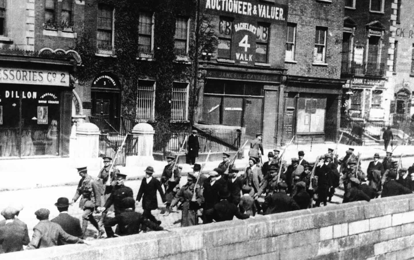 Irish prisoners were marched along a Dublin quay under British guard during  the bloody Irish insurrection that began on Easter Monday, 1916. (AP Photo)