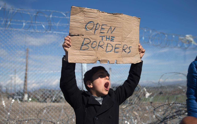 Refugee holding a sign