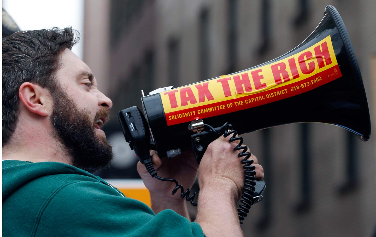 A protester with a bullhorn at a protest in Albany