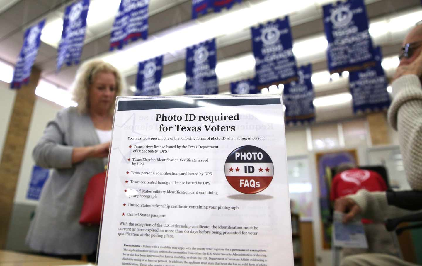 Trumps justice department is no longer opposing texass voter id requirements are posted at a polling site in arlington texas in 2016 ap photo lm otero aiddatafo Choice Image