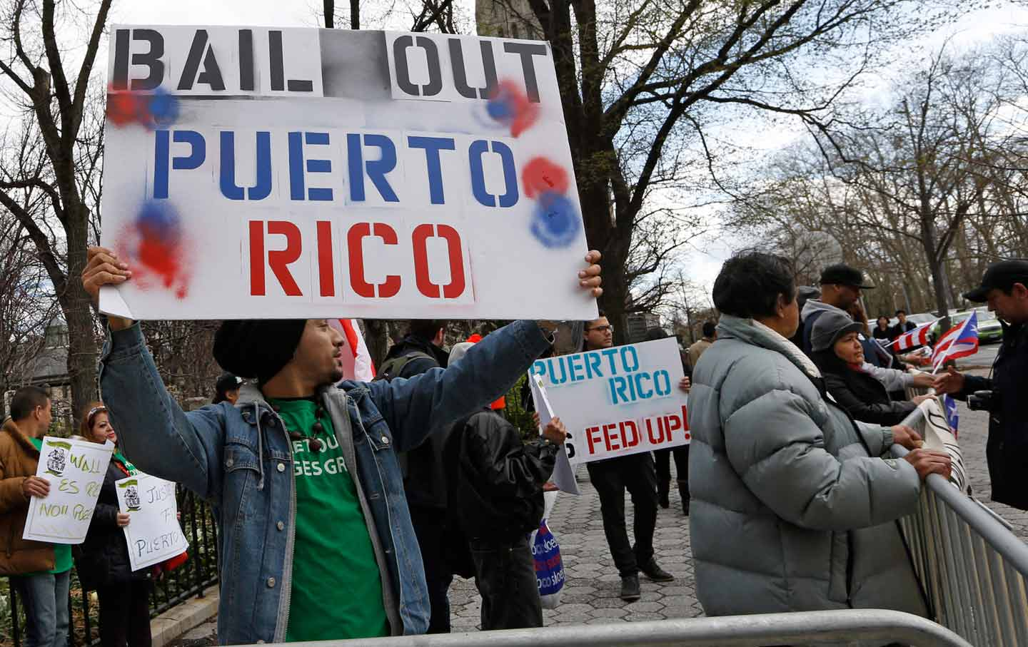 A demonstrator supports bailing out Puerto Rico