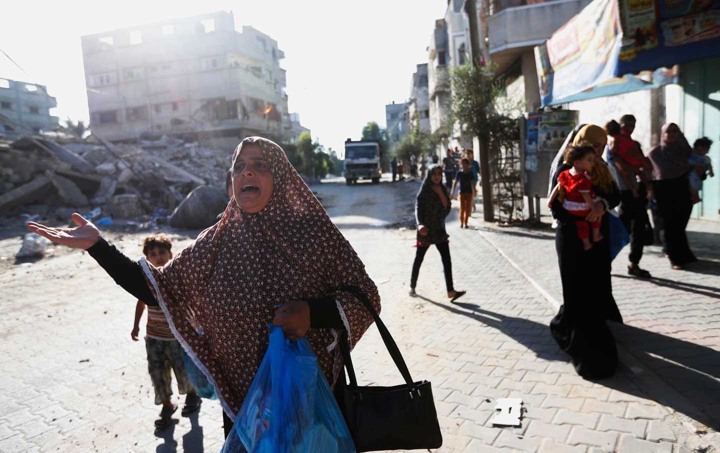 Woman fleeing home in Gaza