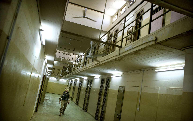 Soldier walks through Abu Ghraib