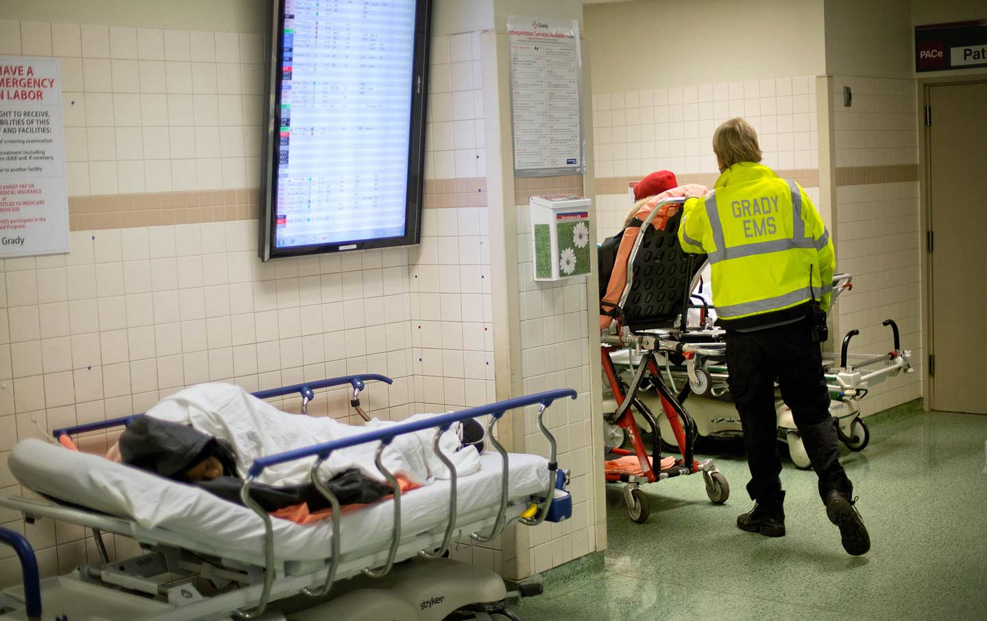 cancer deaths have spiked during the great recession the nation an ems worker wheels a patient through the emergency department at grady memorial hospital in atlanta ap photo david goldman