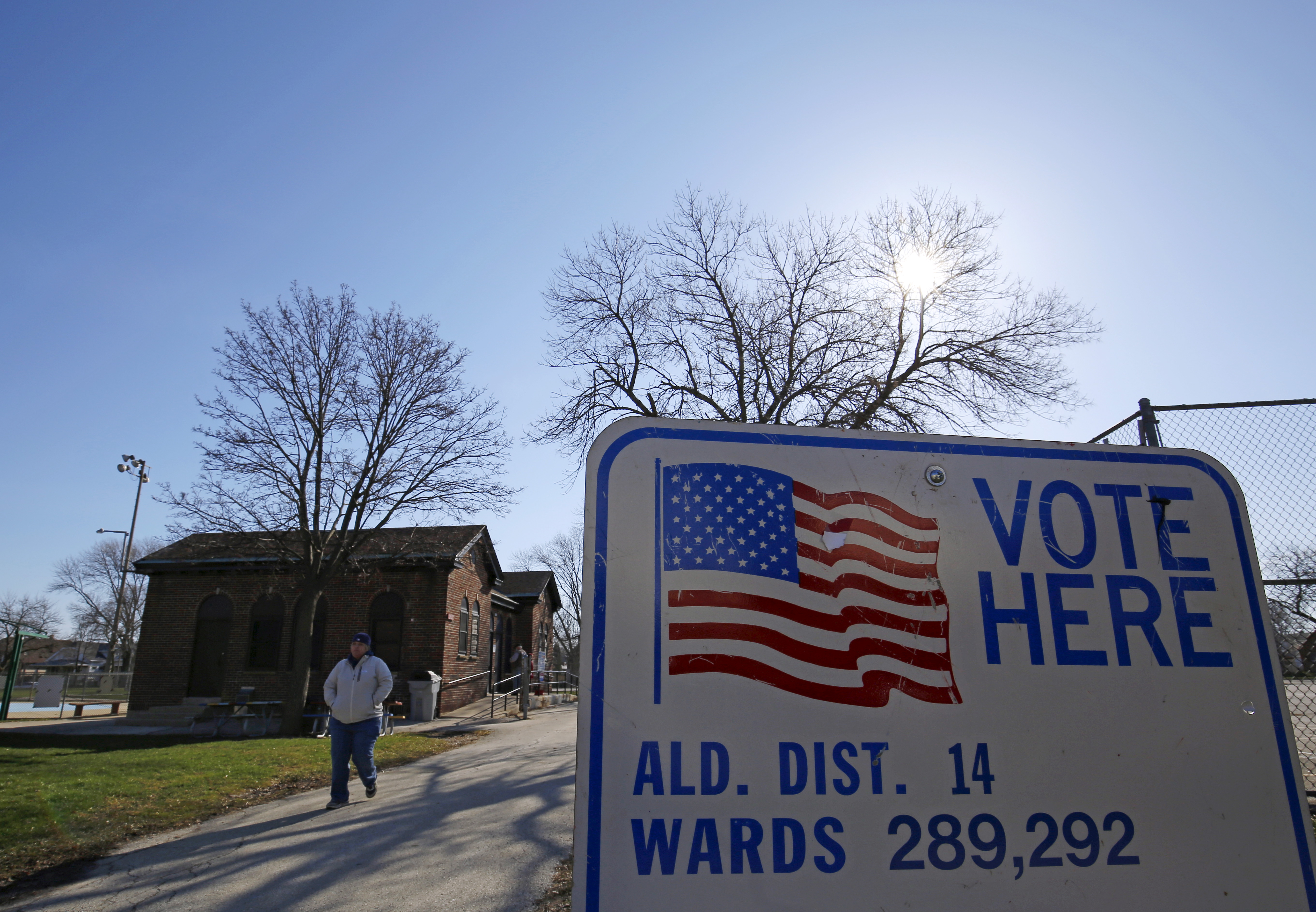 A voter leaves a polling stations after casting their ballot in the Wisconsin presidential primary election in Milwaukee
