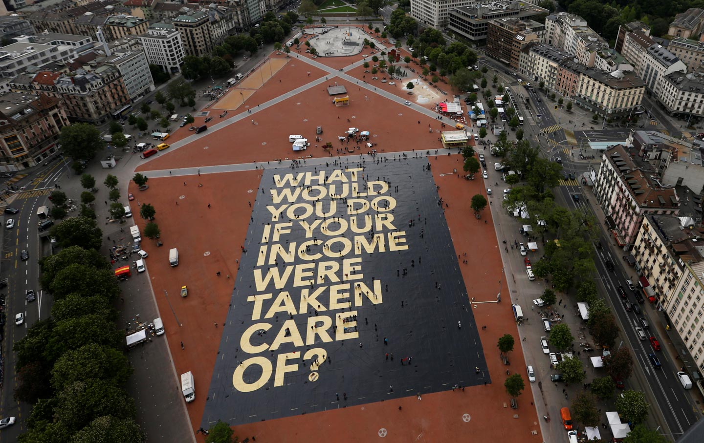 a basic income would upend america s work ethic and that s a good a poster placed by the swiss initiative for an unconditional basic income is displayed on the plainpalais square in geneva switzerland on 14 2016