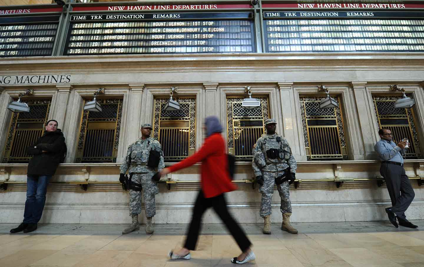 A Woman Walks Past National Guard Solrs In Grand Central Terminal New York City On March 22 2017 The Day After Belgium Terror S