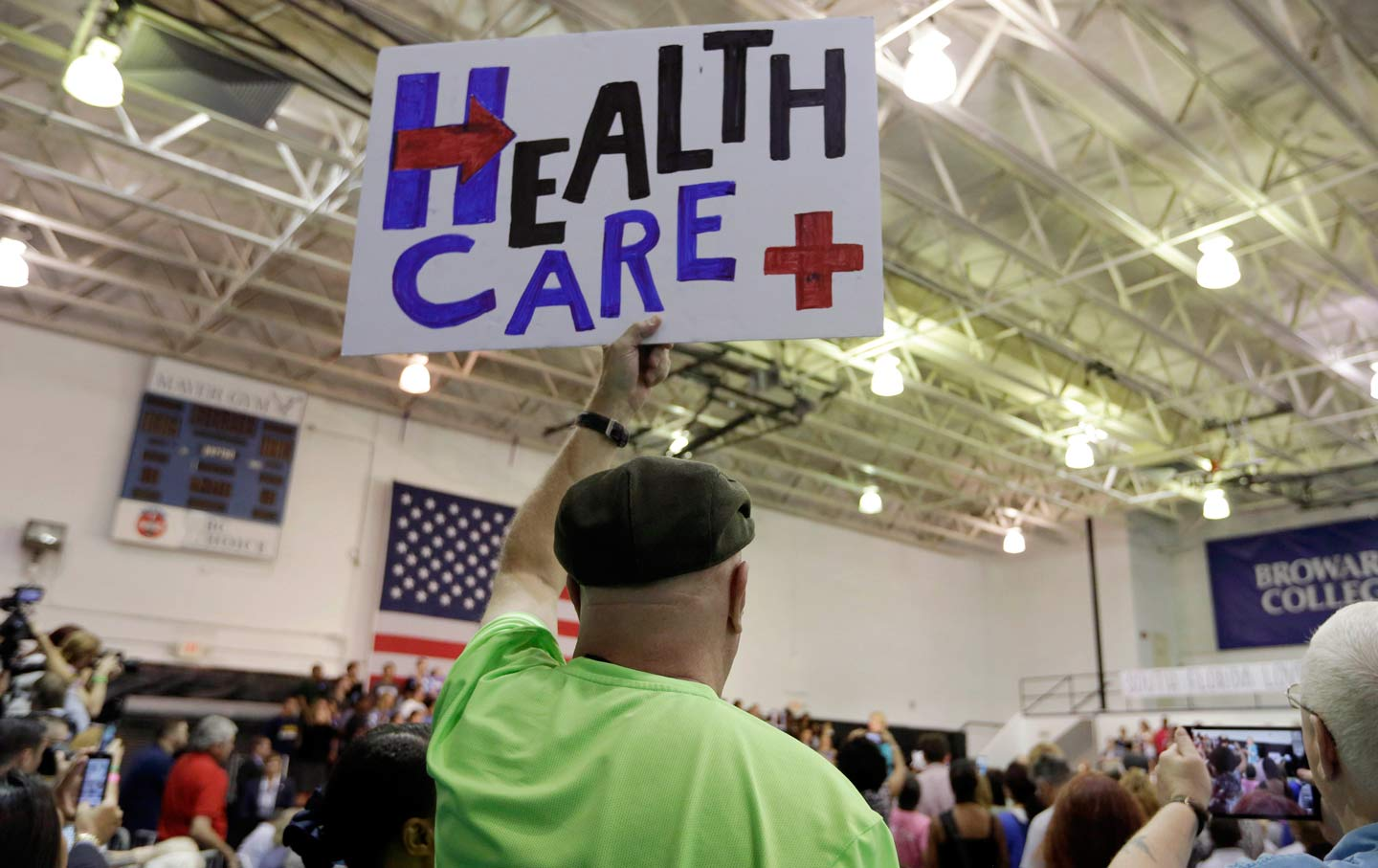 Clinton supporter holds up healthcare sign