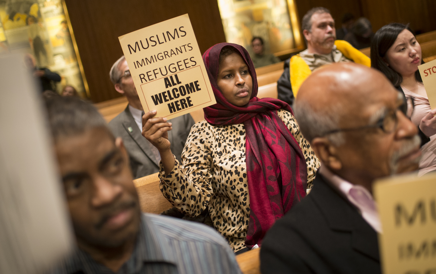 Farhio Khalif, an immigrant from Somalia, holds a sign