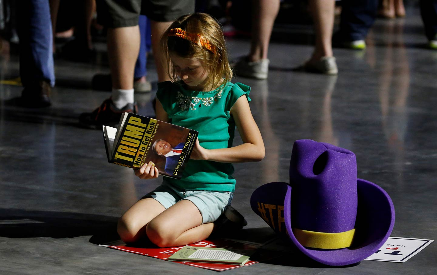 Donald Trump Has Unleashed A New Wave Of Bullying In Schools  The  Hollie Age  Leafs Through A Copy Of Trump How To Get Rich As She Waits  For The Start Of A Trump Rally In Roanoke Virginia On September