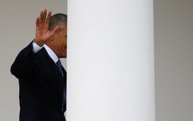 US President Barack Obama departs the Oval Office