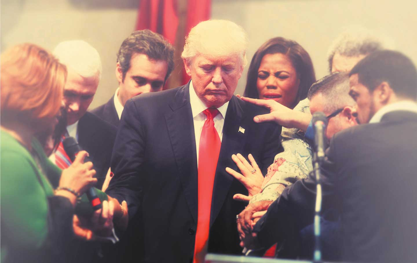 eb650ec06a6 Hands on  Worshippers pray with Donald Trump in Cleveland