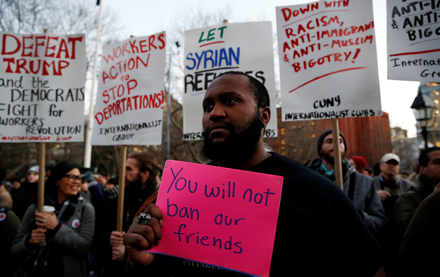 Isaiah Dupree holds a sign as demonstrators gather at Washington Square Park