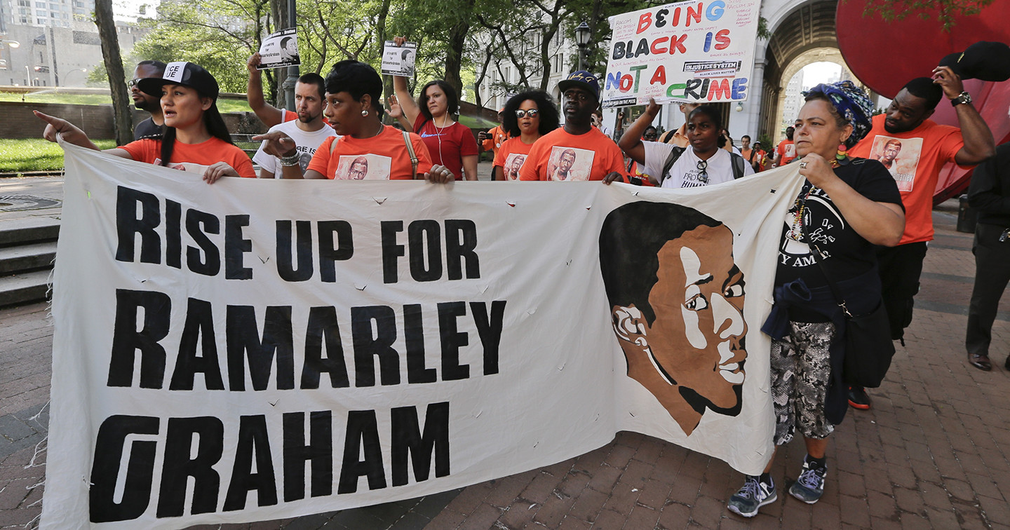 Protestors arrive at One Police Plaza in support of the family of Ramarley Graham Thursday, June 2, 2016, in New York. The mother of Graham, an unarmed black teenager fatally shot by a white policeman in front of his grandmother and young brother joined supporters Thursday for a 17-mile march to police headquarters to demand that the officers involved in the 2012 slaying be fired.