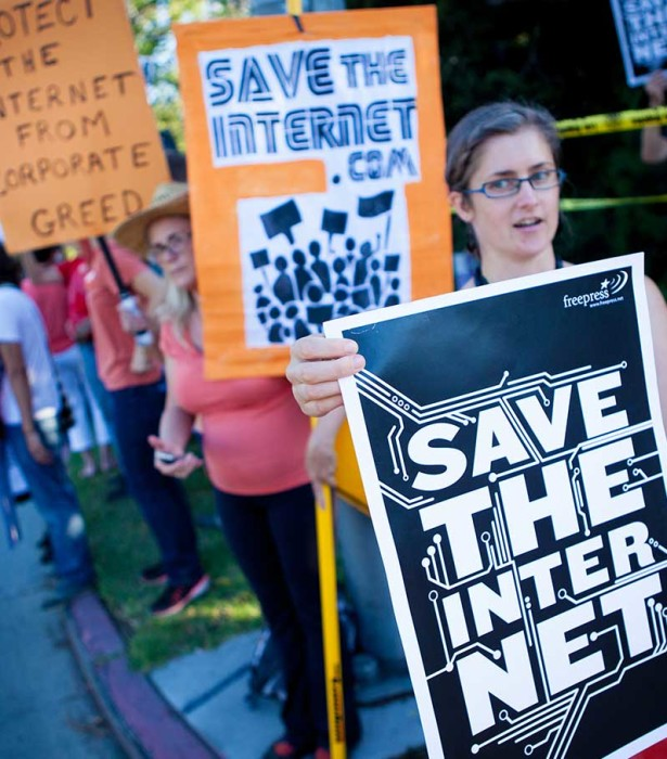 Free Press activists rally for net neutrality.