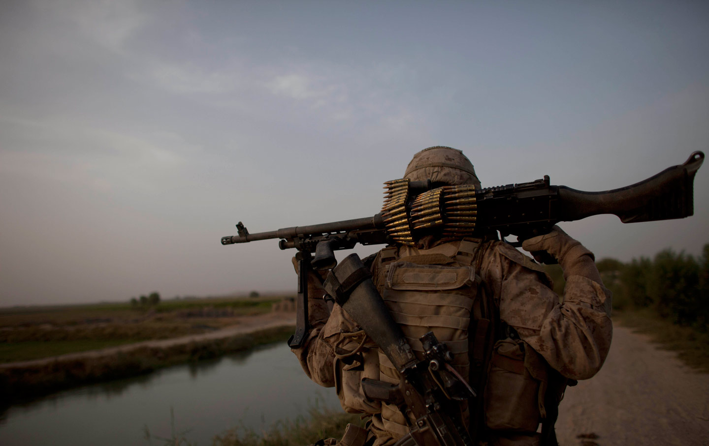 Marine walks in Afghanistan
