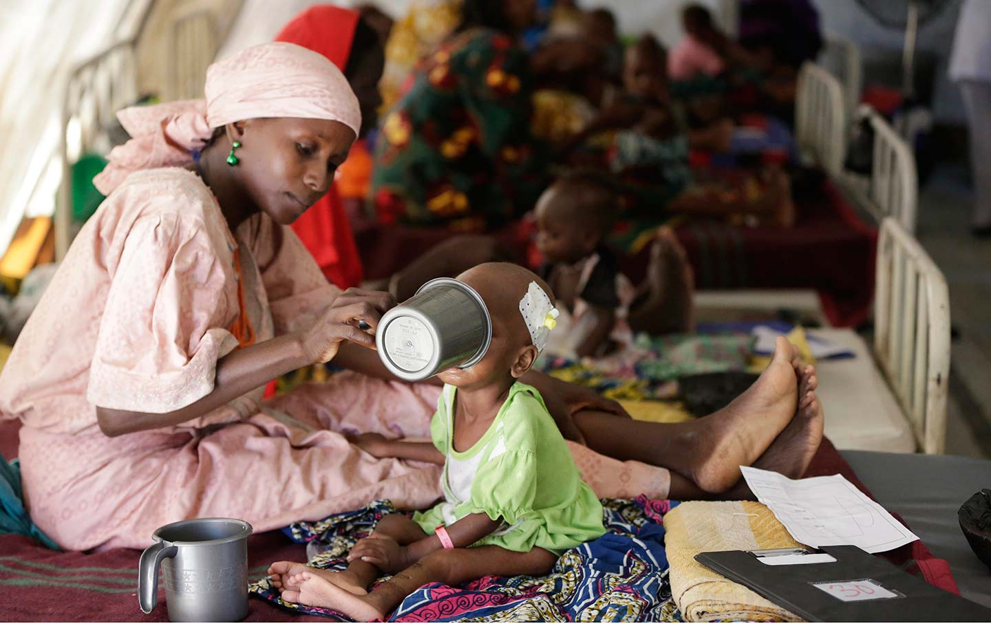 In This August 2016 Photo A Mother Feeds Her Malnourished Child At Feeding Center Run By Doctors Without Borders Maiduguri Nigeria